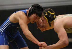 Chris Kim '14 opened his season with two pins for the Panthers.