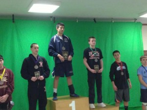 Eighth graders Cliffton Wang (top step) and Mike Schwartz (2nd from right) on the podium.