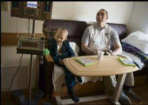 Pitt junior Dan Kornberg, 22, plays a video game with Children's Hospital patient Dalton Smith, 7, of Wellsburg, WV while volunteering at the hospital in Lawrenceville Friday, May 13, 2016. Jasmine Goldband | Tribune-Review
